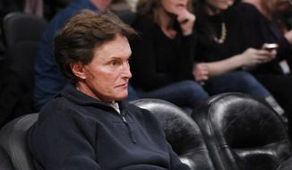 In this Monday, Jan. 16, 2012, photo, former Olympic athlete Bruce Jenner, with stitches and a scar on his face, attends an NBA basketball game between the Dallas Mavericks and Los Angeles Lakers in Los Angeles. Jenner announced in April his plans to transition into a woman in a historic interview with Diane Sawyer. (AP Photo/Danny Moloshok)