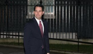 Wisconsin Gov. Scott Walker leaves 10 Downing St. after a private meeting with British Prime Minister David Cameron in London, England, Tuesday, Feb. 10, 2015. (AP Photo/Tim Ireland)
