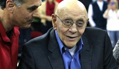 Jerry Tarkanian is escorted by his son, Danny, during halftime ceremonies honoring the former basketball coach at Fresno State University in Fresno, Calif., on March 1, 2014. (Associated Press) **FILE**