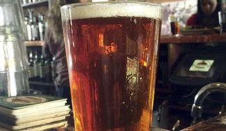 A pint of pub-style ale (Associated Press) **FILE**