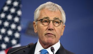 Then-U.S. Secretary of Defense Chuck Hagel speaks during a media conference at NATO headquarters in Brussels in this Feb. 5, 2015, file photo. (AP Photo/Virginia Mayo) ** FILE **