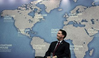 Wisconsin Gov. Scott Walker laughs as he is introduced prior to his speech at Chatham House in central London, Wednesday, Feb. 11, 2015. Walker is leading a coalition of Wisconsin government and business officials on a trade mission in the UK that runs until Friday, Feb. 13, 2015. The trip gives him a chance to bolster his overseas and foreign policy credentials as he considers running for US President in 2016. (AP Photo/Lefteris Pitarakis)