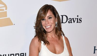 """FILE - In this Feb. 7, 2015 file photo, Melissa Rivers arrives at the 2015 Clive Davis Pre-Grammy Gala in Beverly Hills, Calif. Crown Archetype announced Wednesday, Feb. 11, that her memoir, """"The Book of Joan: Tales of Mirth, Mischief, and Manipulation"""" will come out May 5. According to Crown, an imprint of Penguin Random House, the book will feature jokes, stories and advice. (Photo by John Shearer/Invision/AP, File)"""