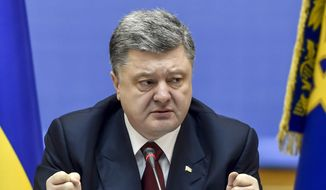 Ukrainian President Petro Poroshenko speaks during a cabinet meeting in Kiev, Ukraine, Wednesday, Feb. 11, 2015. (AP Photo/Mykola Lazarenko, Pool)