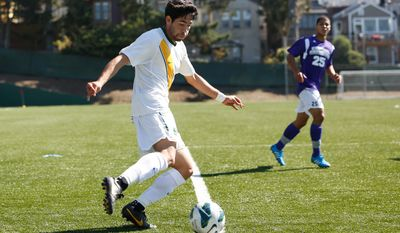 University of San Francisco midfielder Miguel Aguilar kicks the ball in a match against Central Arkansas at Negoesco Stadium in San Francisco on Sept. 14, 2014. Aguilar was drafted in the first round of the 2015 MLS SuperDraft by D.C. United. (Credit University of San Francisco athletics)