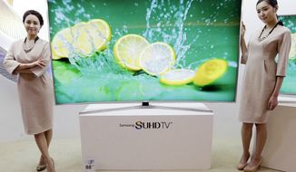 Samsung Electronics introduces its SUHD 4K smart TV in Seoul, South Korea (Associated Press) ** FILE **