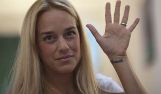 "Lilian Tintori said her husband, opposition leader Leopoldo Lopez, has become the symbolic face of dozens of jailed opposition activists in Venezuela, and of a movement that won't die until there is ""clear justice, a clear rule of law and human rights for all people"" in the nation. (Associated Press)"