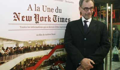 """FILE - In this Nov. 21, 2011, file photo, New York Times journalist David Carr poses for a photograph as he arrives for the French premiere of the documentary """"Page One: A Year Inside The New York Times,"""" in Paris. Carr collapsed at the office and died in a hospital Thursday, Feb. 12, 2015. He was 58. Carr wrote the Media Equation column for the Times, focusing on issues of media in relation to business and culture. (AP Photo/Michel Euler, File)"""