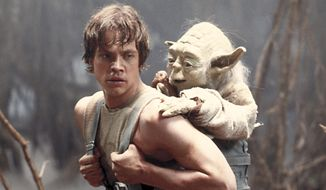 """This image provided by Lucasfilm Ltd. shows Mark Hamill as Luke Skywalker and the character, Yoda, in a scene from the 1980 movie """"Star Wars Episode V: The Empire Strikes Back."""" (AP Photo/Lucasfilm Ltd.)"""