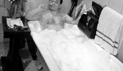 "Actor Edward G. Robinson portrayer of ""tough guy"" parts in the movies, does his best to keep a stern face as he underwent a bubble bath in a movie scene in Hollywood on March 17, 1948. He has his inevitable cigar. (AP Photo)"