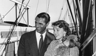 Screen actor Cary Grant, left, is greeted by actress Betsy Drake on his return by cargo ship from England at Los Angeles, Ca., April 7, 1949.  (AP Photo)