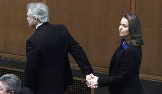 FILE - In this Jan. 12, 2015 file photo, Oregon Gov. John Kitzhaber escorts his fiancee, Cylvia Hayes, onto the House floor before he is sworn in for an unprecedented fourth term as Governor in Salem, Ore. Kitzhaber announced his resignation Friday, Feb. 13, 2015, amid allegations Hayes used her relationship with him to enrich herself.  (AP Photo/Don Ryan, file)