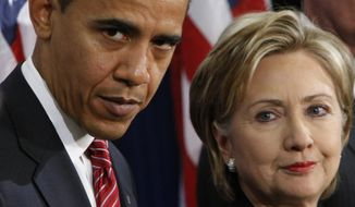 President-elect Barack Obama (left) stands with Sen. Hillary Rodham Clinton, D-N.Y., after announcing that she is his choice as Secretary of State during a news conference in Chicago on Dec. 1, 2008. (Associated Press) **FILE**