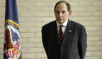 "Veterans Affairs Secretary Robert McDonald says the ""I CARE"" principles ""focus our minds on our mission of caring and thereby guide our actions toward service to others."" ""I CARE"" stands for integrity, commitment, advocacy, respect and excellence. (Associated Press)"