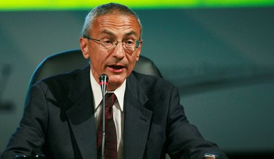 """Outgoing White House adviser John Podesta tweeted 10 regrets about leaving his position, including """"Finally my biggest failure of 2014: Once again not securing the #disclosure of the UFO files."""" (Associated Press)"""