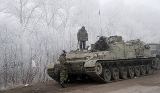 Ukrainian government soldiers were resting Sunday between the towns of Debaltseve and Artemivsk during a reprieve from a conflict that has claimed more than 5,300 lives. (Associated Press)