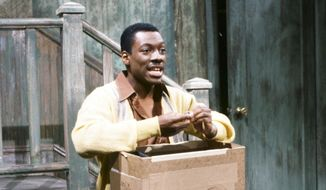 "In this May 13, 1983 photo released by NBC shows Eddie Murphy as Mr. Robinson during the ""Mister Robinson's Neighborhood"" sketch on ""Saturday Night Live,"" in New York. The long-running sketch comedy series will celebrate their 40th anniversary with a 3-hour special airing Sunday at 8 p.m. EST on NBC. (AP Photo/NBC, Al Levine)"