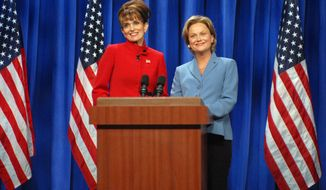 "In this Sept. 13, 2008 photo released by NBC, Tina Fey portrays Alaska Gov. Sarah Palin, left, and Amy Poehler as Sen. Hillary Clinton during a skit on ""Saturday Night Live"" in New York. (AP Photo/NBC, Dana Edelson)"