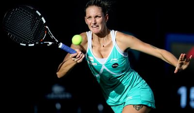 Karolina Pliskova of Czech Republic returns the ball to Anastasia Pavlyuchenkova of Russia during the second day of Dubai Duty Free Tennis Championships in Dubai, United Arab Emirates, Monday, Feb. 16, 2015. (AP Photo/Kamran Jebreili)