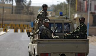 Houthi Shiite Yemenis wearing army uniforms ride in a pickup while patrolling in a street near Republican Palace, in Sanaa, Yemen, Monday, Feb. 16, 2015. (AP Photo/Hani Mohammed)