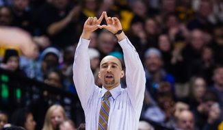 VCU head coach Shaka Smart stands on the sideline during the first half of an NCAA college basketball game against Saint Louis, Tuesday, Feb. 17, 2015, in Richmond, Va. (AP Photo/Zach Gibson)