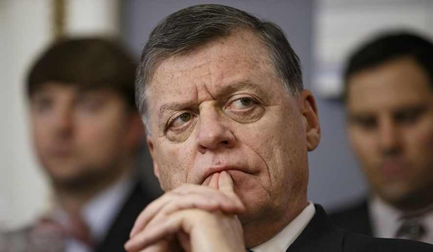 Rep. Tom Cole, R-Okla., listens on Capitol Hill in Washington in this Jan. 7, 2015, file photo. (AP Photo/J. Scott Applewhite, File)