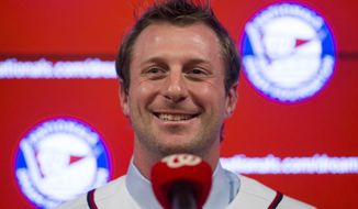 FILE - In this Jan. 21, 2015, file photo, Washington Nationals pitcher Max Scherzer smiles during an introductory news conference at Nationals Park, in Washington. While much of the Northeast and Midwest navigates bitter cold and piles of snow, spring training begins in earnest this week when pitchers and catchers file into camps in Florida and Arizona. The Nationals strengthened their already solid rotation by signing free agent Scherzer to a $210 million, seven-year contract. (AP Photo/Evan Vucci, File)