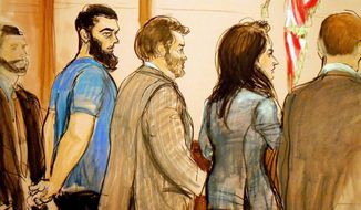 FILE - In this Jan. 7, 2013 file image, Abid Naseer, second from left, is arraigned in Brooklyn Federal Court where he pleaded not guilty through his attorney Steven Brounstein, center, to terrorism charges in an alleged al-Qaida plot against the New York City subways. Second from right is Assistant U.S. Attorney Zainab Ahmad. Naseer is expected to give an opening statement Tuesday, Feb. 17, 2015, in federal court in New York City. (AP Photo/Elizabeth Williams, File)