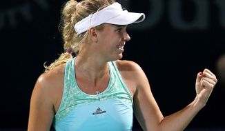 Caroline Wozniacki of Denmark celebrates after she beats Samantha Stosur of Australia during the third day of the Dubai Duty Free Tennis Championships in Dubai, United Arab Emirates, Tuesday, Feb. 17, 2015. (AP Photo/Kamran Jebreili)