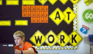 Sixth grader Alex Greuey, 11, reads through a problem in the English Language Arts section of the PARCC (Partnership for Assessment of Readiness for College and Careers). (AP Photo/Ty Wright)