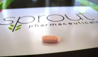 In this Friday, Sept. 27, 2013, file photo, a tablet of flibanserin sits on a brochure for Sprout Pharmaceuticals in the company's Raleigh, N.C., headquarters. The pill has been twice rejected, but Sprout Pharmaceuticals said Tuesday, Feb. 17, 2015, it is refiling its application for flibanserin, adding new information requested by the Food and Drug Administration about how the pill affects driving ability. (AP Photo/Allen G. Breed, File)