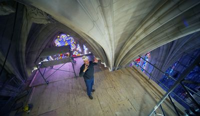 Head Mason Joe Alonso talks about repairs of the stonework at the Washington National Cathedral on scaffolding 65 feet above the nave floor. The Cathedral has finished the first phase of restoration work needed after an earthquake in 2011. (Associated Press photographs)