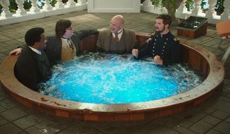 "From left: Craig Robinson, Clark Duke, Rob Corddry and Adam Scott soak in some fun while filming the ludicrous sequel ""Hot Tub Time Machine 2."" (Associated Press)"