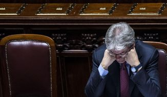 """Italian Foreign Minister Paolo Gentiloni listens to opposition lawmakers at the Lower Chamber in Rome, Wednesday, Feb. 18, 2015. Italy pressed for swifter action Wednesday by the United Nations to find a political solution to Libya's rapidly deteriorating security situation. Foreign Minister Paolo Gentiloni, speaking in Parliament, urged the world to """"quicken its pace before it is too late."""" Egypt this week launched airstrikes in neighboring Libya after the Islamic State group posted a video of the beheadings of 21 Egyptian Coptic Christians there. (AP Photo/Angelo Carconi, Ansa)"""
