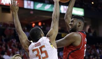 Maryland forward Damonte Dodd (35) blocks a shot attempt by Nebraska forward Leslee Smith in the first half of an NCAA college basketball game, Thursday, Feb. 19, 2015, in College Park, Md. (AP Photo/Patrick Semansky)