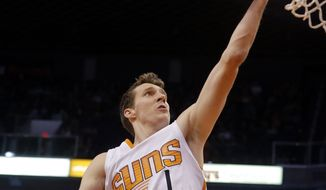 FILE - In this Jan. 19, 2015, file photo, Phoenix Suns guard Goran Dragic (1) scores against the Los Angeles Lakers in the third quarter during an NBA basketball game in Phoenix. A person with knowledge of the trade says Goran Dragic has been sent to the Miami Heat by the Phoenix Suns in a deal that also involves the New Orleans Pelicans. The person says Dragic and his brother Zoran Dragic have both been dealt to Miami in a deal that was struck not long before Thursday's, Feb. 19, 2015,  3 p.m. league-wide trade deadline. The person spoke to The Associated Press on condition of anonymity because the transaction had yet to be approved by NBA officials. (AP Photo/Rick Scuteri, File)