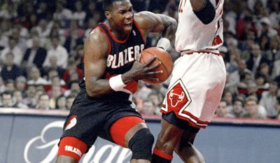 FILE - In this June 14, 1992, file photo, Chicago Bulls' Michael Jordan, right, tries to hold off Portland Trail Blazers' Jerome Kersey during Game 6 in basketball's NBA Finals in Chicago. Kersey, the small forward who played his first 11 NBA seasons with the Blazers and helped the San Antonio Spurs(...)