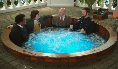 """Clark Duke (second from left) starred with Craig Robinson), Rob Corddry and Adam Scott in """"Hot Tub Time Machine 2."""" (AP)"""