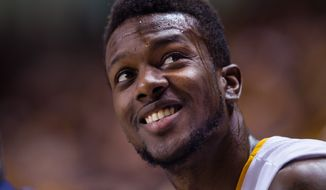 VCU guard JeQuan Lewis smiles during the first half of an NCAA college basketball game against Massachusetts at the Siegel Center in Richmond, Va., on Saturday, Feb. 21, 2015.  (AP Photo/Zach Gibson)