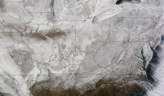 "The big snow storm from space: The NASA satellite Terra has snapped the picture of the Eastern U.S. from 200 miles up - and in the words of the space agency, it ""looks like a deep freeze."" (NASA Goddard MODIS Rapid Response Team)"