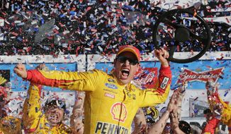 Joey Logano celebrates in Victory Lane after winning the Daytona 500 NASCAR Sprint Cup series auto race at Daytona International Speedway, Sunday, Feb. 22, 2015, in Daytona Beach, Fla. (AP Photo/Chuck Burton)
