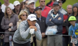 James Hahn watches his drive on the 10th tee in the final round of the Northern Trust Open golf tournament at Riviera Country Club in the Pacific Palisades area of Los Angeles Sunday, Feb. 22, 2015. (AP Photo/Mark J. Terrill)