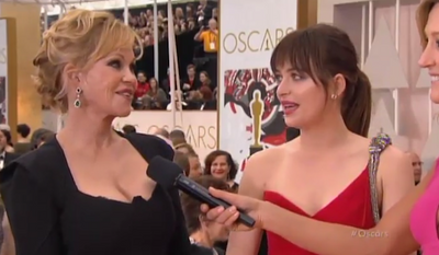 """Before the Oscars even began Sunday night, the Twitterverse was lighting up over """"Fifty Shades of Grey"""" star Dakota Johnson and her mother, actress Melanie Griffith, who gave an awesomely awkward interview that only moms and daughters can pull off. (ABC via Mediaite)"""