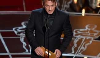 Sean Penn presents the award for best picture at the Oscars on Sunday, Feb. 22, 2015, at the Dolby Theatre in Los Angeles. (Photo by John Shearer/Invision/AP)