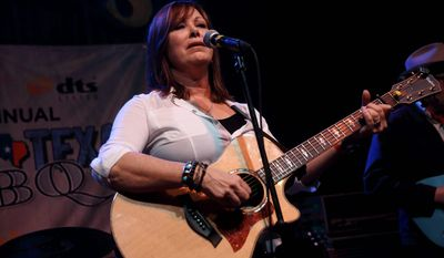 "Suzy Bogguss' new show will include some of her original songs, selections from her 2011 ""American Folk Songbook"" and brand-new material from the album she is recording. (Associated Press)"