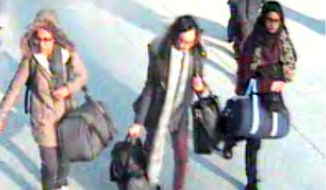 This is a still taken from CCTV issued by the Metropolitan Police in London on Monday Feb. 23, 2015,  of 15-year-old Amira Abase, left,  Kadiza Sultana,16, centre, and Shamima Begum, 15, going through Gatwick airport, south of London, before they caught their flight to Turkey on Tuesday Feb 17, 2015. The three teenage girls left the country in a suspected bid to travel to Syria to join the Islamic State extremist group. (AP Photo/Metropolitan Police)