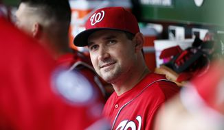 Washington Nationals left fielder Ryan Zimmerman (11) pauses in the dugout before a baseball game against the Miami Marlins at Nationals Park, Sunday, Sept. 28, 2014, in Washington. (AP Photo/Alex Brandon)