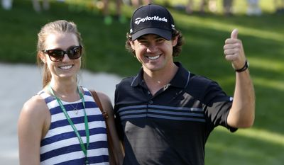 Brian Harman and his fiance; Kelly Van Slyke smile after Harman won the 2014 John Deere Classic golf tournament at TPC Deere Run in Silvis, Ill., Sunday, July 13, 2014. (AP Photo/Charles Rex Arbogast)
