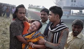 A Bangladeshi woman cries after identifying the body of her relative, victim of a capsized ferry in Manikganj district, about 40 kilometers (25 miles) northwest of Dhaka, Bangladesh, Monday, Feb. 23, 2015. (AP Photo/A.M. Ahad)