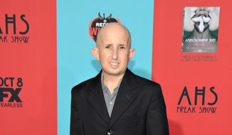 "Ben Woolf arrives at the premiere screening of ""American Horror Story: Freak Show"" at TCL Chinese Theatre, in Los Angeles, Calif., in this Oct. 5, 2014, file photo.  Woolf died Monday afternoon, Feb. 23, 2015, at Cedars-Sinai Medical Center in Los Angeles, publicist Zack Teperman said. (Photo by Tonya Wise/Invision/AP, File)"